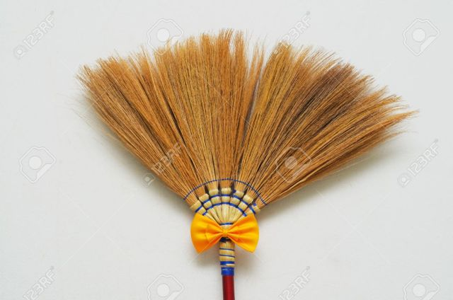10018277-broomstick-with-yellow-bow-tie-stock-photo